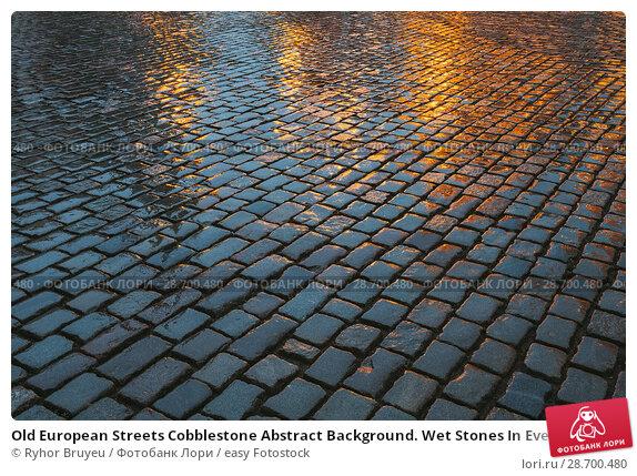 Купить «Old European Streets Cobblestone Abstract Background. Wet Stones In Evening Or Night Illuminations. Travel Abstract Background.», фото № 28700480, снято 3 июля 2016 г. (c) easy Fotostock / Фотобанк Лори