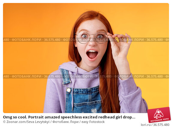 Omg so cool. Portrait amazed speechless excited redhead girl drop... Стоковое фото, фотограф Zoonar.com/Seva Levytskyi / easy Fotostock / Фотобанк Лори