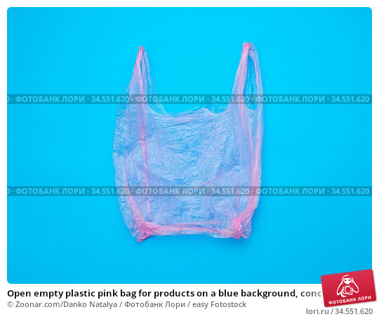 Open empty plastic pink bag for products on a blue background, concept... Стоковое фото, фотограф Zoonar.com/Danko Natalya / easy Fotostock / Фотобанк Лори
