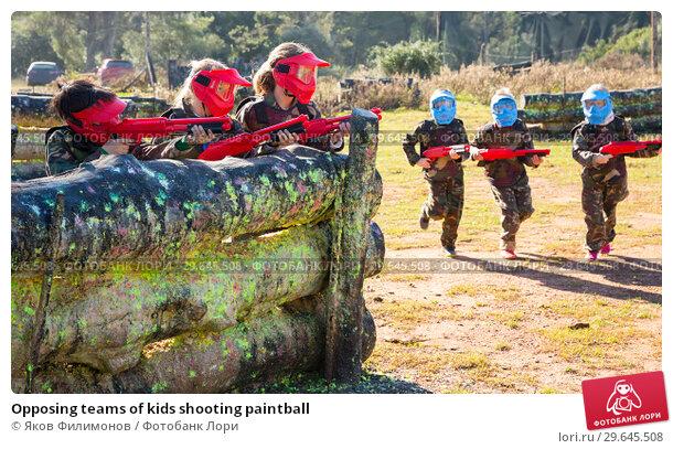 Купить «Opposing teams of kids shooting paintball», фото № 29645508, снято 24 ноября 2018 г. (c) Яков Филимонов / Фотобанк Лори