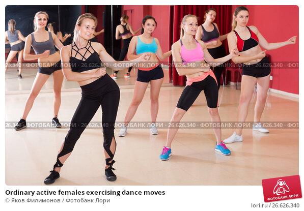Купить «Ordinary active females exercising dance moves», фото № 26626340, снято 31 мая 2017 г. (c) Яков Филимонов / Фотобанк Лори