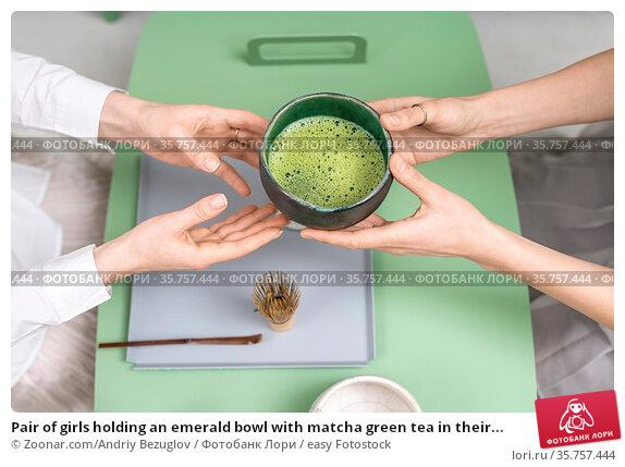 Pair of girls holding an emerald bowl with matcha green tea in their... Стоковое фото, фотограф Zoonar.com/Andriy Bezuglov / easy Fotostock / Фотобанк Лори