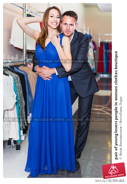 pair of young lovers people in women clothes boutique. Стоковое фото, фотограф Яков Филимонов / Фотобанк Лори