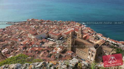 Купить «Panoramic bird's-eye view of the central part of the Sicilian town of Cefalu. Cefalu is one of the major tourist attractions in the Sicily region, Italy», видеоролик № 30841572, снято 29 мая 2019 г. (c) Алексей Кузнецов / Фотобанк Лори