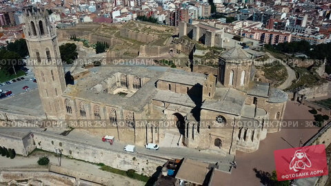 Купить «Panoramic view from drone of Catalan city of Lleida with medieval Cathedral of St. Mary of La Seu Vella», видеоролик № 30818256, снято 25 июля 2018 г. (c) Яков Филимонов / Фотобанк Лори