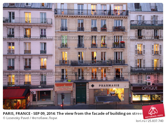 Купить «PARIS, FRANCE - SEP 09, 2014: The view from the facade of building on street Rue La Fayette in Paris in the evening», фото № 25837740, снято 9 сентября 2014 г. (c) Losevsky Pavel / Фотобанк Лори