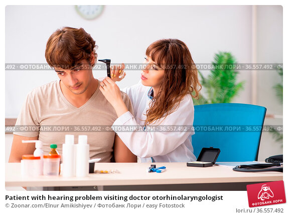 Patient with hearing problem visiting doctor otorhinolaryngologist. Стоковое фото, фотограф Zoonar.com/Elnur Amikishiyev / easy Fotostock / Фотобанк Лори