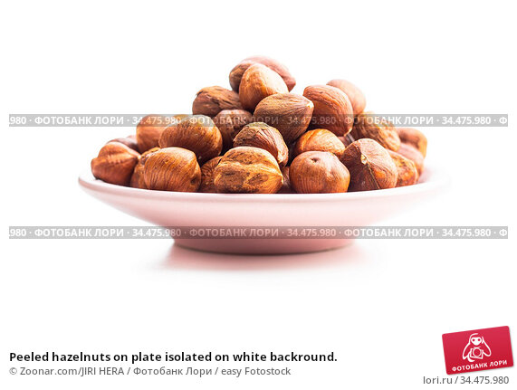 Peeled hazelnuts on plate isolated on white backround. Стоковое фото, фотограф Zoonar.com/JIRI HERA / easy Fotostock / Фотобанк Лори