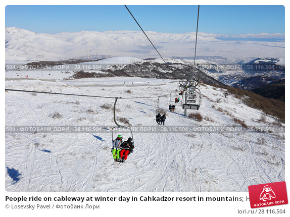 Купить «People ride on cableway at winter day in Cahkadzor resort in mountains; Hrazdan town far away», фото № 28116504, снято 7 января 2017 г. (c) Losevsky Pavel / Фотобанк Лори