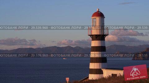 Купить «Petropavlovsk Lighthouse on Pacific Coast of Kamchatka Peninsula», видеоролик № 29539960, снято 15 октября 2018 г. (c) А. А. Пирагис / Фотобанк Лори