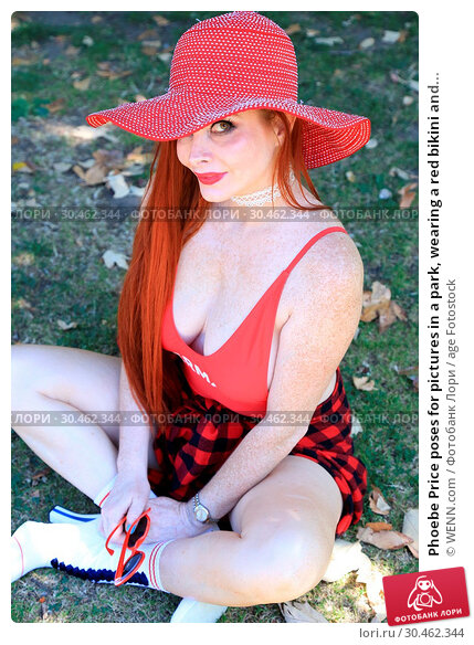 Phoebe Price poses for pictures in a park, wearing a red bikini and... (2017 год). Редакционное фото, фотограф WENN.com / age Fotostock / Фотобанк Лори