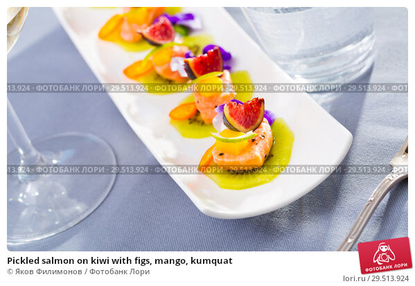 Купить «Pickled salmon on kiwi with figs, mango, kumquat», фото № 29513924, снято 23 февраля 2019 г. (c) Яков Филимонов / Фотобанк Лори