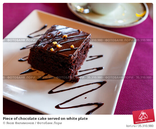 Piece of chocolate cake served on white plate. Стоковое фото, фотограф Яков Филимонов / Фотобанк Лори