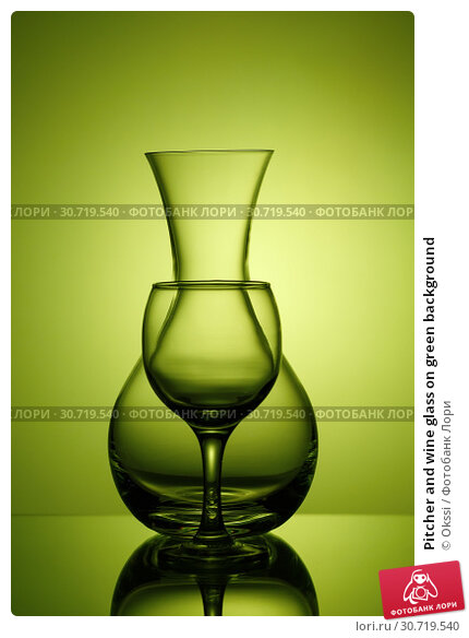 Купить «Pitcher and wine glass on green background», фото № 30719540, снято 23 апреля 2019 г. (c) Okssi / Фотобанк Лори