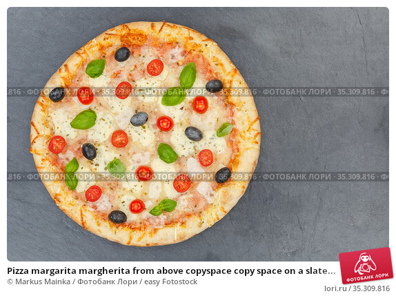 Pizza margarita margherita from above copyspace copy space on a slate... Стоковое фото, фотограф Markus Mainka / easy Fotostock / Фотобанк Лори