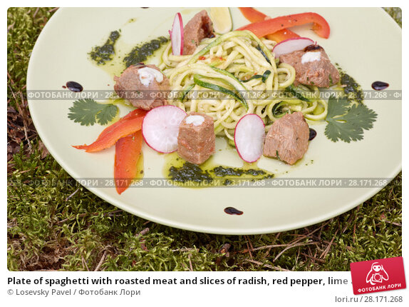 Купить «Plate of spaghetti with roasted meat and slices of radish, red pepper, lime and herbs», фото № 28171268, снято 22 апреля 2019 г. (c) Losevsky Pavel / Фотобанк Лори
