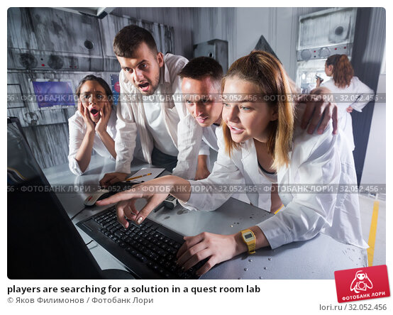 Купить «players are searching for a solution in a quest room lab», фото № 32052456, снято 6 июля 2017 г. (c) Яков Филимонов / Фотобанк Лори