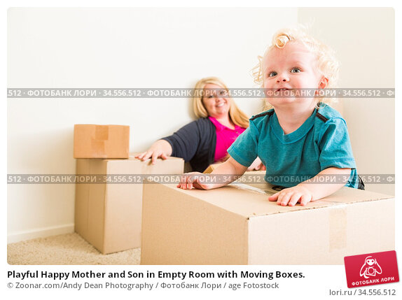 Playful Happy Mother and Son in Empty Room with Moving Boxes. Стоковое фото, фотограф Zoonar.com/Andy Dean Photography / age Fotostock / Фотобанк Лори