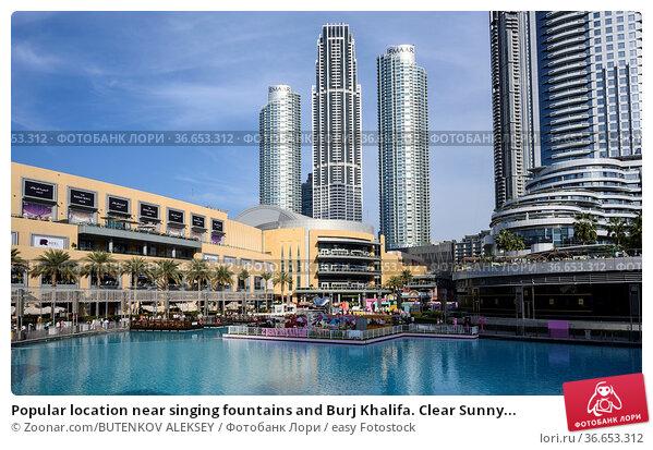 Popular location near singing fountains and Burj Khalifa. Clear Sunny... Стоковое фото, фотограф Zoonar.com/BUTENKOV ALEKSEY / easy Fotostock / Фотобанк Лори