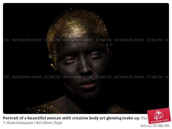 Купить «Portrait of a beautiful woman with creative body art glowing make up. Face is colored with black paint.», фото № 27386756, снято 7 января 2018 г. (c) Женя Канашкин / Фотобанк Лори