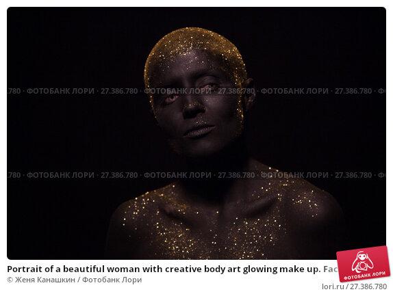 Купить «Portrait of a beautiful woman with creative body art glowing make up. Face is colored with black paint.», фото № 27386780, снято 7 января 2018 г. (c) Женя Канашкин / Фотобанк Лори
