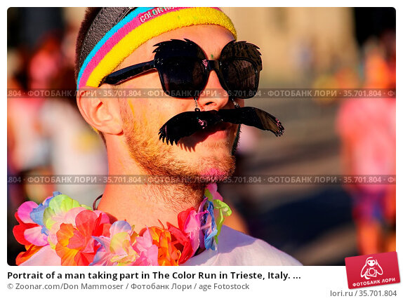Portrait of a man taking part in The Color Run in Trieste, Italy. ... Стоковое фото, фотограф Zoonar.com/Don Mammoser / age Fotostock / Фотобанк Лори