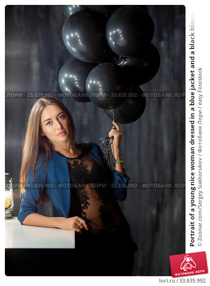 Купить «Portrait of a young nice woman dressed in a blue jacket and a black blouse holding balloons in the rivers», фото № 33835992, снято 30 мая 2020 г. (c) easy Fotostock / Фотобанк Лори