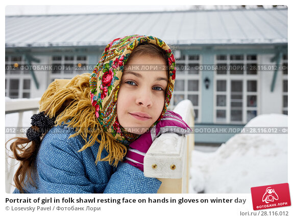 Купить «Portrait of girl in folk shawl resting face on hands in gloves on winter day», фото № 28116012, снято 4 февраля 2017 г. (c) Losevsky Pavel / Фотобанк Лори