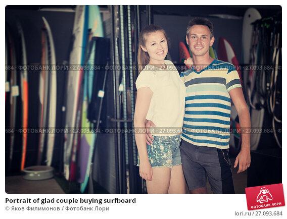 Купить «Portrait of glad couple buying surfboard», фото № 27093684, снято 1 августа 2017 г. (c) Яков Филимонов / Фотобанк Лори