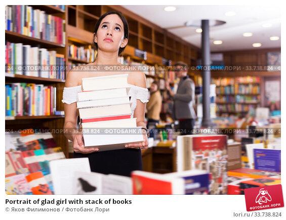 Купить «Portrait of glad girl with stack of books», фото № 33738824, снято 18 января 2018 г. (c) Яков Филимонов / Фотобанк Лори