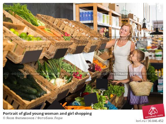 Купить «Portrait of glad young woman and girl shopping», фото № 30846452, снято 18 июля 2019 г. (c) Яков Филимонов / Фотобанк Лори