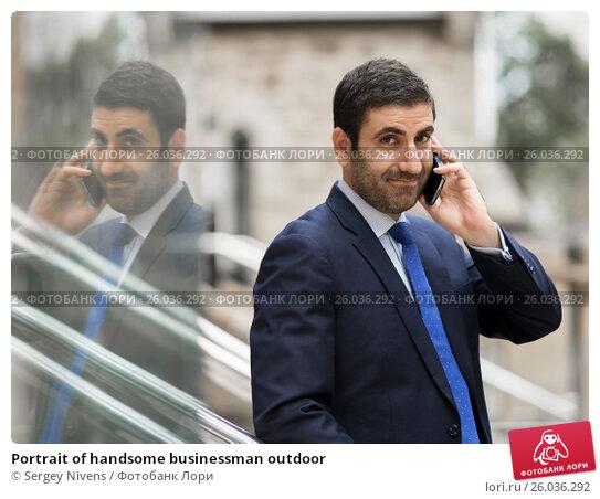 Купить «Portrait of handsome businessman outdoor», фото № 26036292, снято 4 апреля 2015 г. (c) Sergey Nivens / Фотобанк Лори