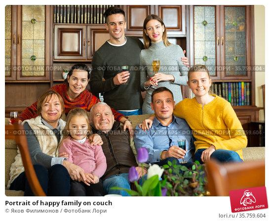 Portrait of happy family on couch. Стоковое фото, фотограф Яков Филимонов / Фотобанк Лори