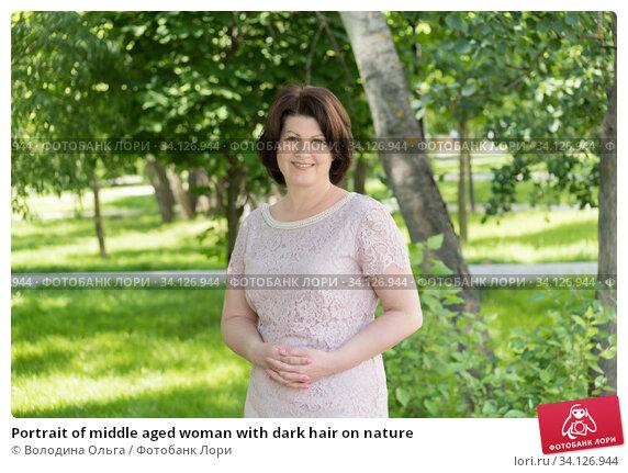 Купить «Portrait of middle aged woman with dark hair on nature», фото № 34126944, снято 27 июня 2020 г. (c) Володина Ольга / Фотобанк Лори