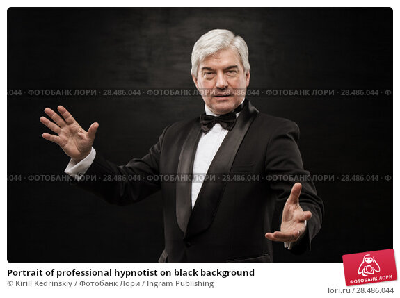 Купить «Portrait of professional hypnotist on black background», фото № 28486044, снято 28 января 2013 г. (c) Ingram Publishing / Фотобанк Лори