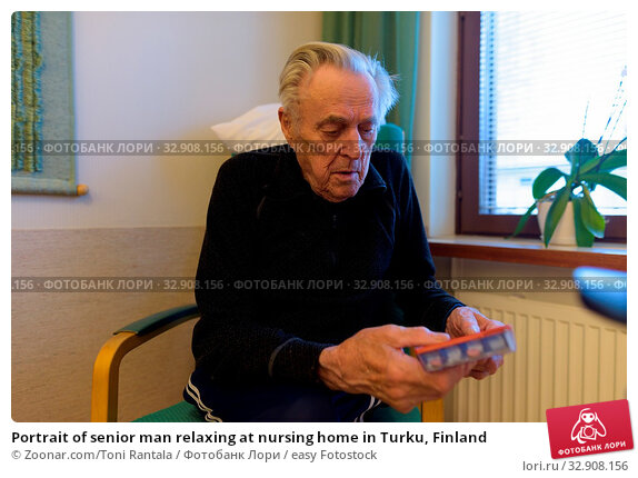 Portrait of senior man relaxing at nursing home in Turku, Finland. Стоковое фото, фотограф Zoonar.com/Toni Rantala / easy Fotostock / Фотобанк Лори