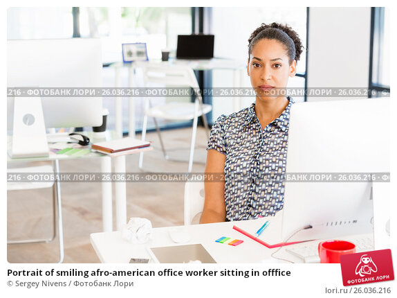 Portrait of smiling afro-american office worker sitting in offfice, фото № 26036216, снято 13 декабря 2014 г. (c) Sergey Nivens / Фотобанк Лори