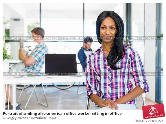 Купить «Portrait of smiling afro-american office worker sitting in offfice», фото № 26036224, снято 13 декабря 2014 г. (c) Sergey Nivens / Фотобанк Лори