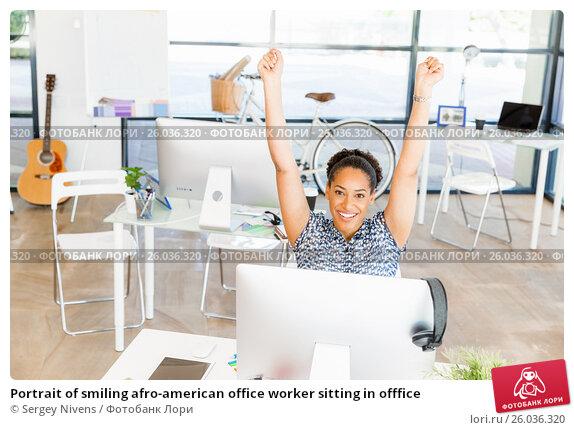 Купить «Portrait of smiling afro-american office worker sitting in offfice», фото № 26036320, снято 13 декабря 2014 г. (c) Sergey Nivens / Фотобанк Лори