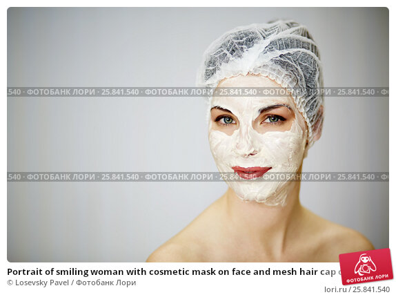 Купить «Portrait of smiling woman with cosmetic mask on face and mesh hair cap on head», фото № 25841540, снято 1 марта 2015 г. (c) Losevsky Pavel / Фотобанк Лори