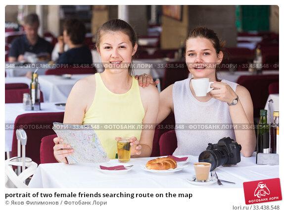 Купить «portrait of two female friends searching route on the map», фото № 33438548, снято 29 мая 2017 г. (c) Яков Филимонов / Фотобанк Лори