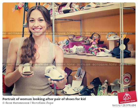 Купить «Portrait of woman looking after pair of shoes for kid», фото № 28978684, снято 22 апреля 2019 г. (c) Яков Филимонов / Фотобанк Лори