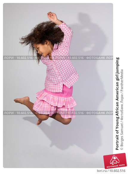 Portrait of Young African American girl jumping. Стоковое фото, фотограф Borges Samuel / PantherMedia / Фотобанк Лори