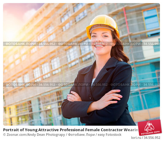 Portrait of Young Attractive Professional Female Contractor Wearing... Стоковое фото, фотограф Zoonar.com/Andy Dean Photograpy / easy Fotostock / Фотобанк Лори
