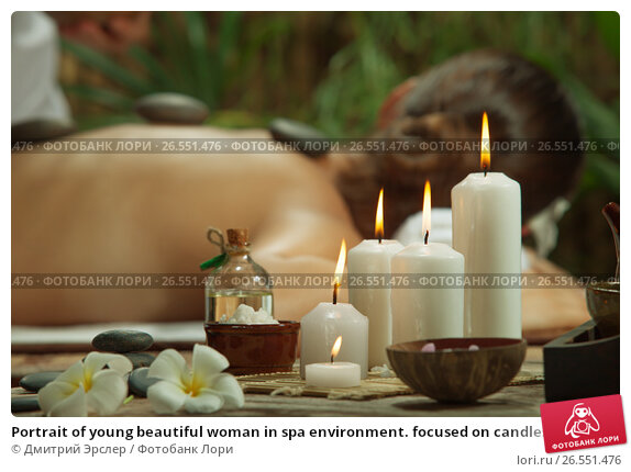 Portrait of young beautiful woman in spa environment. focused on candles., фото № 26551476, снято 27 марта 2016 г. (c) Дмитрий Эрслер / Фотобанк Лори