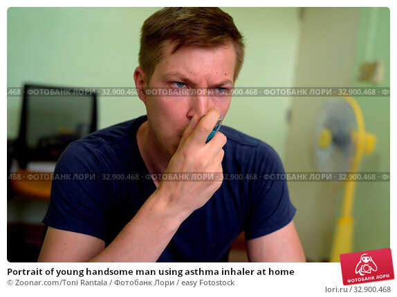 Portrait of young handsome man using asthma inhaler at home. Стоковое фото, фотограф Zoonar.com/Toni Rantala / easy Fotostock / Фотобанк Лори