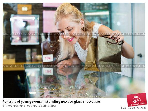 Купить «Portrait of young woman standing next to glass showcases», фото № 29658980, снято 21 февраля 2019 г. (c) Яков Филимонов / Фотобанк Лори
