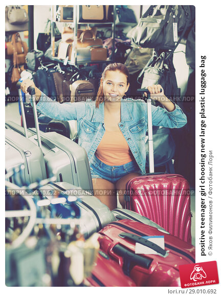 Купить «positive teenager girl choosing new large plastic luggage bag», фото № 29010692, снято 15 сентября 2016 г. (c) Яков Филимонов / Фотобанк Лори