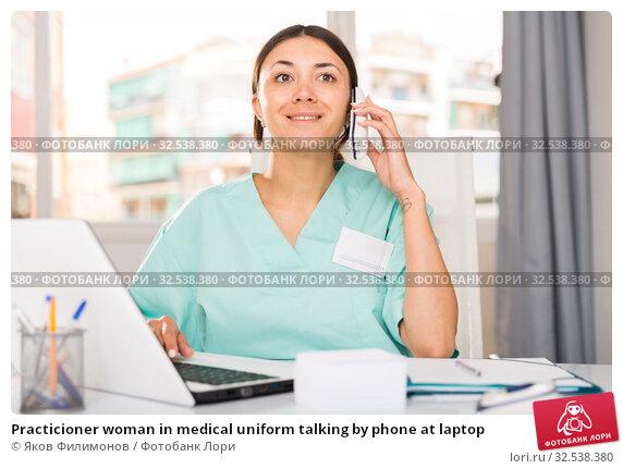 Купить «Practicioner woman in medical uniform talking by phone at laptop», фото № 32538380, снято 1 мая 2018 г. (c) Яков Филимонов / Фотобанк Лори