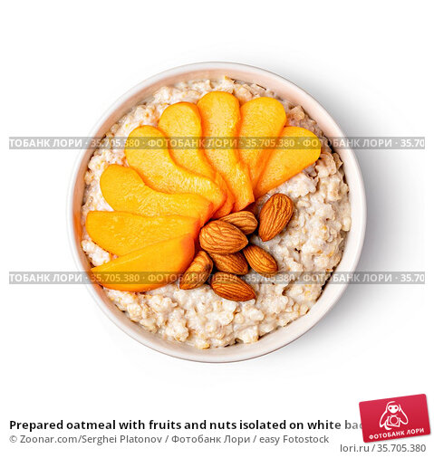 Prepared oatmeal with fruits and nuts isolated on white background. Стоковое фото, фотограф Zoonar.com/Serghei Platonov / easy Fotostock / Фотобанк Лори